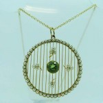 15ct Gold Peridot & 60 Pearls Pendant. Click for more information...