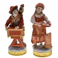 Pair of German Volkstedt Porcelain Figurines. Click for more information...