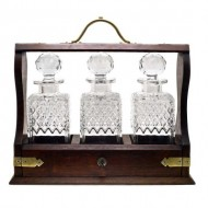 3 Bottle Oak Tantalus With Silver Plate Mounts. Click for more information...