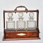 3 Bottle Oak Tantalus with Silver Plate Mounts.. Click for more information...