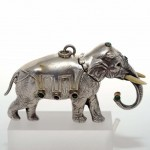 Rare Silver Elephant Perfume Bottle. Ivory and Silver Tester. Stones Set. Click for more information...