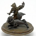 Chinese Bronze. Man with Mythological Dog. Click for more information...